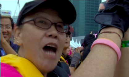 Yoke Chan cheering her team at the World Championships - screengrab from Pink Paddlers film